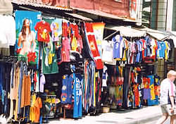 Chania tourist shop, tea-shirts to beach towels, football shirts, hats, summer clothes.